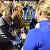 Broomfield High's first pom squad member Judy Peak Fitzsimmons, left, class of '67, greets  members of the current pom squad during Friday's Broomfield High homecoming game at Elizabeth Kennedy Stadium.<br /> September 21, 2012<br /> staff photo/ David R. Jennings