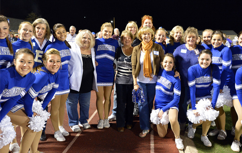 Pom squad members pose for pictures  with the first pom squad and cheerleaders of Broomfield High during Friday's Broomfield High homecoming game at Elizabeth Kennedy Stadium.<br /> September 21, 2012<br /> staff photo/ David R. Jennings