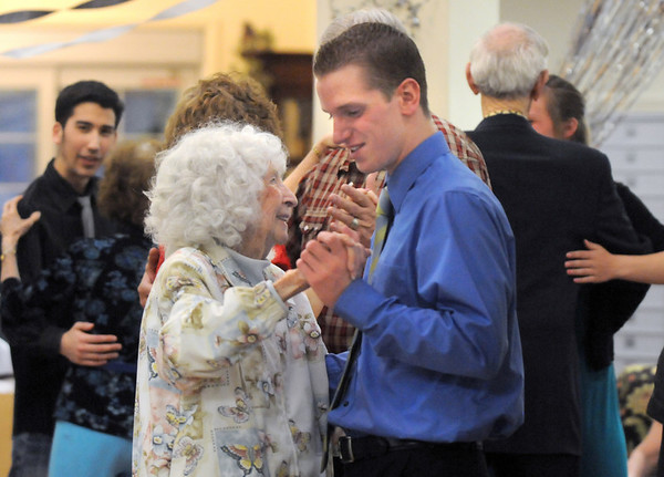 Byrness Hunter, 90, left, dances with Keller Reeves, 16, during the Broomfield High School's Future Business Leaders of America and Key Club Senior Citizen Prom Saturday at the Highland Trails Retirement Homes.<br /> <br /> April 11, 2010<br /> Staff photo/David R. Jennings