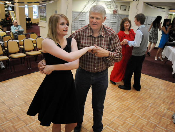 Cherie Martin, 16, left,  dances with Bob Johnson while Leona James dances with Luke Carpenter, 17, during the Broomfield High School's Future Business Leaders of America and Key Club Senior Citizen Prom at Highland Trails Retirement Homes on Saturday.<br /> <br /> April 11, 2010<br /> Staff photo/David R. Jennings