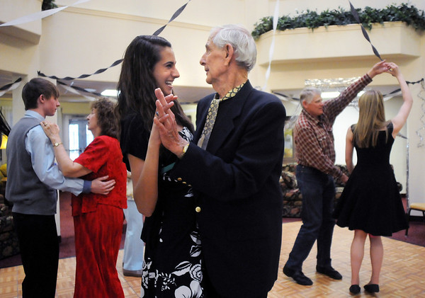 Bud Stoecker dances with Whitney Hull, 16, during the Broomfield High School's Future Business Leaders of America and Key Club Senior Citizen Prom at Highland Trails Retirement Homes on Saturday.<br /> <br /> April 11, 2010<br /> Staff photo/David R. Jennings