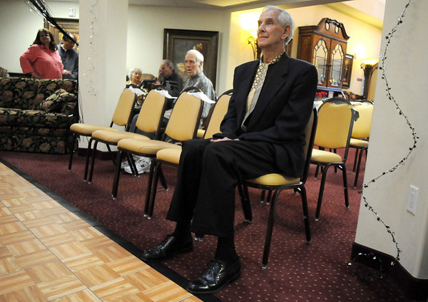 Bud Stoecker, right, waits to be called to the dance floor during the Broomfield High School's Future Business Leaders of America and Key Club Senior Citizen Prom at Highland Trails Retirement Homes on Saturday.<br /> April 11, 2010<br /> Staff photo/David R. Jennings