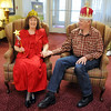 Leona James, left, and Bob Johnson, wearing prom king and queen crowns, pose for pictures during the Broomfield High School's Future Business Leaders of America and Key Club Senior Citizen Prom at Highland Trails Retirement Homes on Saturday.<br /> <br /> April 11, 2010<br /> Staff photo/David R. Jennings