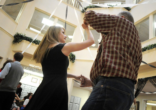 Cherie Martin, 16, left, is taught a dance by Bob Johnson during the Broomfield High School's Future Business Leaders of America and Key Club Senior Citizen Prom at Highland Trails Retirement Homes on Saturday.<br /> <br /> April 11, 2010<br /> Staff photo/David R. Jennings
