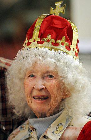 Byrness Hunter, 90, wearing a crown poses for pictures during the Broomfield High School's Future Business Leaders of America and Key Club Senior Citizen Prom at Highland Trails Retirement Homes on Saturday.<br /> <br /> April 11, 2010<br /> Staff photo/David R. Jennings