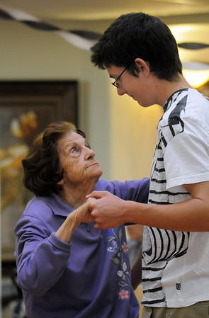 Lorraine Devling, left, dances with Vincent Hauser, 17, during the Broomfield High School's Future Business Leaders of America and Key Club Senior Citizen Prom at Highland Trails Retirement Homes.<br /> <br /> April 11, 2010<br /> Staff photo/David R. Jennings