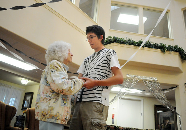 Byrness Hunter, 90, left, dances with Vincent Hauser, 17, during the Broomfield High School's Future Business Leaders of America and Key Club Senior Citizen Prom at Highland Trails Retirement Homes on Saturday.<br /> <br /> April 11, 2010<br /> Staff photo/David R. Jennings
