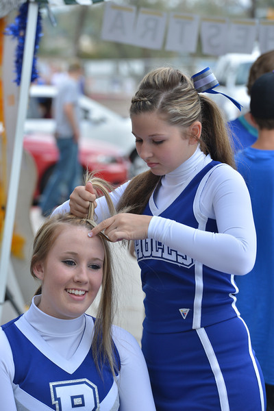 Cheerleaders Stephanie Reynolds, right, braids Ashley Wolfe's hair at the tailgate party prior to the Broomfield vs. Legacy football game at Elizabeth Kennedy Stadium on Friday.<br /> September 7, 2012<br /> staff photo/ David R. Jennings
