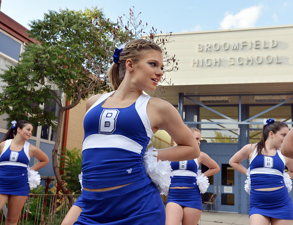 Caroline Oliver prepares to dance with the Broomfield Poms squad at the tailgate party prior to the Broomfield vs. Legacy football game at Elizabeth Kennedy Stadium on Friday.<br /> September 7, 2012<br /> staff photo/ David R. Jennings