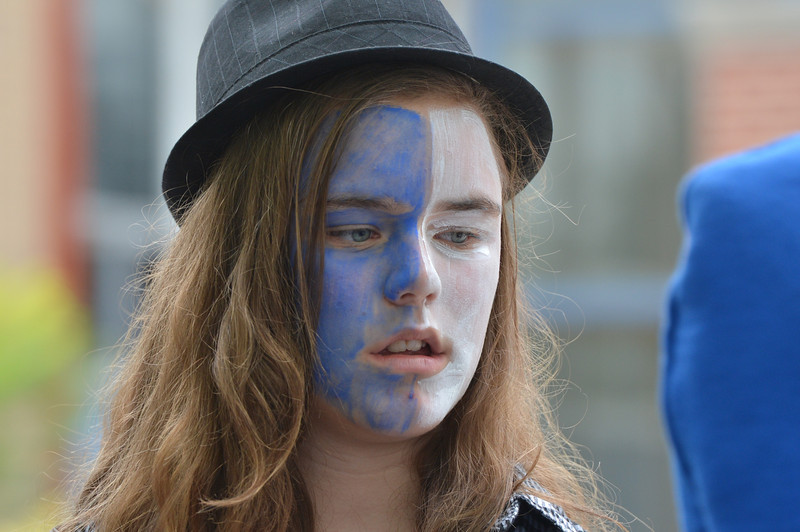Mary Haydon, 13, had her face painted in the Eagle's blue and white at the tailgate party prior to the Broomfield vs. Legacy football game at Elizabeth Kennedy Stadium on Friday.<br /> September 7, 2012<br /> staff photo/ David R. Jennings