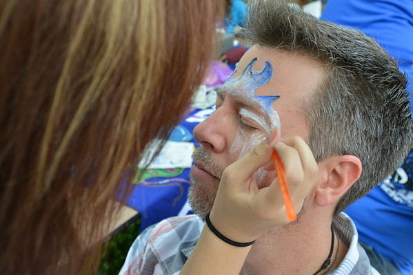 Broomfield High teacher Robert Scott has his face painted by  senior Saleena Normanleier at the tailgate party prior to the Broomfield vs. Legacy football game at Elizabeth Kennedy Stadium on Friday.<br /> September 7, 2012<br /> staff photo/ David R. Jennings
