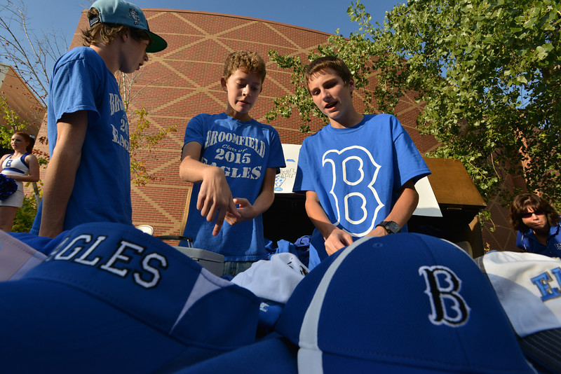 Sophomores Ken Rathmann, left, Lane Beu, and Tanner Maxwell sell spirit gear at the tailgate party prior to the Broomfield vs. Legacy football game at Elizabeth Kennedy Stadium on Friday.<br /> September 7, 2012<br /> staff photo/ David R. Jennings