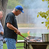 Ken Chrisman, right, and Philip Cangilla man the grill cooking hamburgers and hot dogs at the tailgate party prior to the Broomfield vs. Legacy football game at Elizabeth Kennedy Stadium on Friday.<br /> September 7, 2012<br /> staff photo/ David R. Jennings