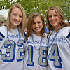 Sophomores Karley Wietharn, left, Paige Grunewald and Kennedy Jankowski pose for a picture at the tailgate party prior to the Broomfield vs. Legacy football game at Elizabeth Kennedy Stadium on Friday.<br /> September 7, 2012<br /> staff photo/ David R. Jennings