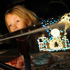 Mackenzie Caldwell, 4,  looks over the window of her grand parents car to get a better view of the lighting display at 13941 Tincup Circle.<br /> <br /> December 13, 2009<br /> Staff photo/David R. Jennings
