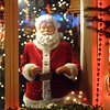 A mechanical Santa looks out at visitors in the holiday lighting display at 1188 Clubhouse Drive.<br /> <br /> December 13, 2009<br /> Staff photo/David R. Jennings
