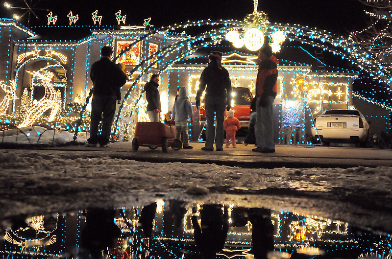Visitors take in the 13941 Tincup Circle holiday lighting display.<br /> <br /> December 13, 2009<br /> Staff photo/David R. Jennings