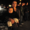 Pamela Yaden, a Tincup Circle neighbor, holds her son Avery, 8 months-old as they look at the 13941 Tincup Circle holiday lighting display.<br /> <br /> December 13, 2009<br /> Staff photo/David R. Jennings