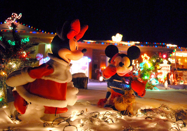 """Minnie Mouse and Mickey Mouse """" ice skate""""  in the holiday display at 155 Hemlock St.<br /> <br /> December 12, 2009<br /> Staff photo/David R. Jennings"""