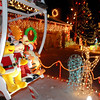 A toy Mickey Mouse, Pooh Bear and Tigger ride the Ferris wheel in the holiday display at 1188 Clubhouse Drive.<br /> <br /> December 13, 2009<br /> Staff photo/David R. Jennings