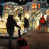 Visitors gaze at the 13941 Tincup Circle holiday lighting display.<br /> <br /> December 13, 2009<br /> Staff photo/David R. Jennings
