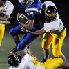 Hayden Underberg, Broomfield, is tackled by  Thompson Valley players during the homecoming game at Elizabeth Kennedy Stadium on Friday.<br /> <br /> October 2, 2009<br /> Staff photo/David R. Jennings