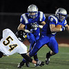 Dan Guebelle, Broomfield, breaks a tackle by Dalton Lynch, Thompson Valley, during the homecoming game at Elizabeth Kennedy Stadium on Friday.<br /> <br /> October 2, 2009<br /> Staff photo/David R. Jennings