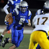 Dan Guebelle, Broomfield carries the ball downfield through the Thompson Valley line  during the homecoming game at Elizabeth Kennedy Stadium on Friday.<br /> <br /> October 2, 2009<br /> Staff photo/David R. Jennings