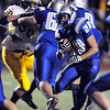 Sean Gentry, right, Broomfield works his way through the line during the homecoming game against Thompson Valley at Elizabeth Kennedy Stadium on Friday.<br /> <br /> October 2, 2009<br /> Staff photo/David R. Jennings