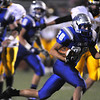 Sean Gentry, right, Broomfield carries the ball downfield during the homecoming game against Thompson Valley at Elizabeth Kennedy Stadium on Friday.<br /> <br /> October 2, 2009<br /> Staff photo/David R. Jennings