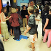 People attending the open house for JAM, Just After Midnight, after prom party fill the hallway while visiting the different themed rooms including the Project Runway restroom decorated by Wendy Fiedler, left, at Broomfield High School on Saturday.<br /> April 16, 2011<br /> staff photo/David R. Jennings