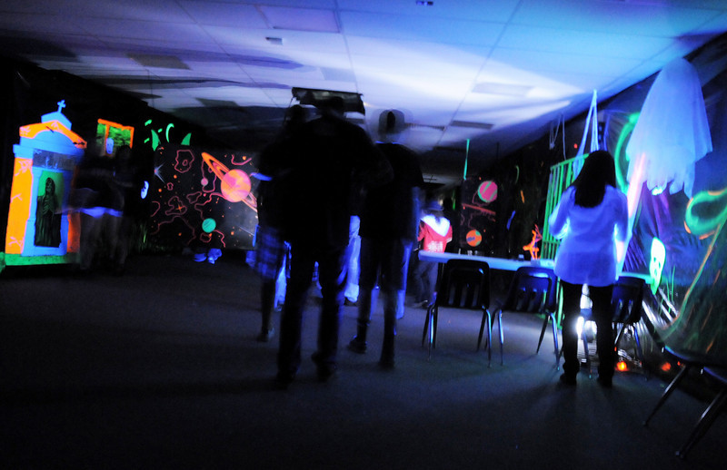 Attendees look at the laser tag room bathed in ultraviolet light during the open house for JAM, Just After Midnight, after prom party at Broomfield High School on Saturday.<br /> April 16, 2011<br /> staff photo/David R. Jennings