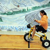 Hope Kim, 12, rides a tricycle in the Ice Road Truckers room while attending the open house for JAM, Just After Midnight, after prom party at Broomfield High School on Saturday.<br /> April 16, 2011<br /> staff photo/David R. Jennings
