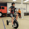 Tayor Lindquist, 13, and Hope Kim, 12, ride tricycles in the Ice Road Truckers room while attending the open house for JAM, Just After Midnight, after prom party at Broomfield High School on Saturday.<br /> April 16, 2011<br /> staff photo/David R. Jennings