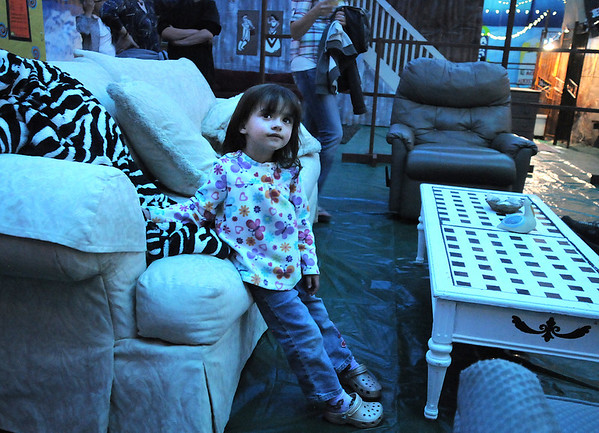 Ashlyn Barrowcliff, 3, tries out the funrature in the Jersey Shore room while attending the open house for JAM, Just After Midnight, after prom party at Broomfield High School on Saturday.<br /> April 16, 2011<br /> staff photo/David R. Jennings