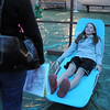 Emily Peterson, 10, tries out the lounge chair in the Jersey Shore room during the open house for JAM, Jsut After Midnight, after prom party at Broomfield High School on Saturday.<br /> April 16, 2011<br /> staff photo/David R. Jennings