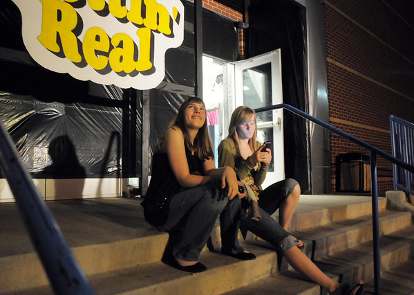 Brittany Heye, 15, left, and Lauren Nalezny, 14, sit on the stairs outside of the entrance to JAM, Just After Midnight, after prom party during the open house at Broomfield High School on Saturday.<br /> April 16, 2011<br /> staff photo/David R. Jennings