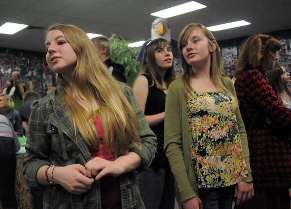 Bridget Admire, 15, left, looks at senior posters with Brittany Heye, 15, and Lauren Nalezny, 14, during the open house for JAM, Just After Midnight, after prom party at Broomfield High School on Saturday.<br /> April 16, 2011<br /> staff photo/David R. Jennings