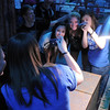 Chelsea Sterling, 15, right, takes a picture in a mirror with Lauren Roberts, 15, and Mary Dartez, 15, while in the Jersey Shore room  during the open house for JAM, Just After Midnight, after prom party at Broomfield High School on Saturday.<br /> April 16, 2011<br /> staff photo/David R. Jennings