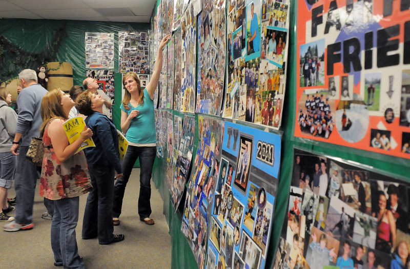 Amy Spicer, left, Carol Spicer and Sarah Montoya look at the senior posters while attending the open house for JAM, Just After Midnight, after prom party at Broomfield High School on Saturday.<br /> April 16, 2011<br /> staff photo/David R. Jennings