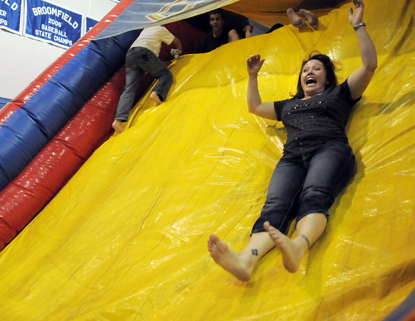 Robyn Steitz takes a trip down the slide during the open house for JAM, Just After Midnight, after prom party at Broomfield High School on Saturday.<br /> April 16, 2011<br /> staff photo/David R. Jennings