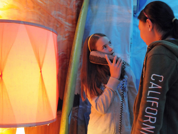 Emily Peterson, 10, left, with her sister Elisa Peterson, 12, tests a duck phone in the Jersey Shore room while attending the open house for JAM, Just After Midnight, after prom party at Broomfield High School on Saturday.<br /> April 16, 2011<br /> staff photo/David R. Jennings