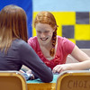 Taylor Lindquist, 13, right, pretends to play black jack with Nicole Timson, 13, in the Celebrity Poker room while attending the open house for JAM, Just After Midnight, after prom party at Broomfield High School on Saturday.<br /> April 16, 2011<br /> staff photo/David R. Jennings