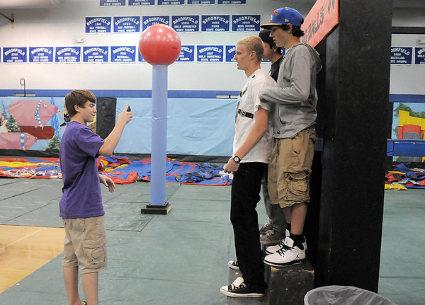 Will Feicht, 15, left, takes a picture of Dan Perse, 16, Brett Alfrey, 16, and Darin Wnostroza, 16, during the open house for JAM, Just After Midnight, after prom party at Broomfield High School on Saturday.<br /> April 16, 2011<br /> staff photo/David R. Jennings