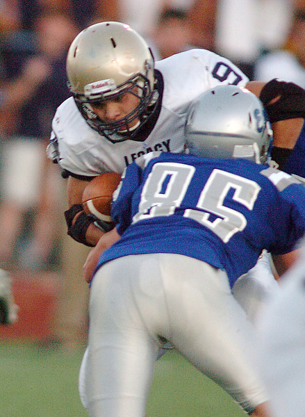BE0919FOOT08<br /> Dezmon Fernandez, Legacy, is tackled by Kristain Niemi, Broomfield, during Saturday's cross town game at Elizabeth Kennedy Stadium..<br /> <br /> September 11, 2010<br /> staff photo/David R. Jennings