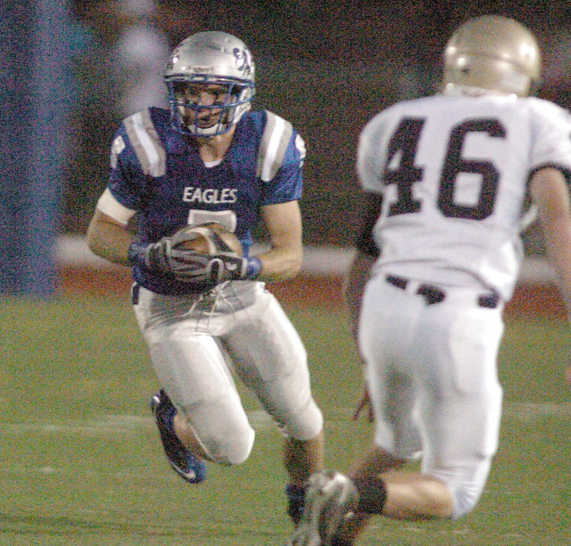 BE0919FOOT12<br /> Broomfield's Dan Geubelle carries the ball downfield against Legacy xx during Saturday's cross town game at Elizabeth Kennedy Stadium..<br /> <br /> September 11, 2010<br /> staff photo/David R. Jennings