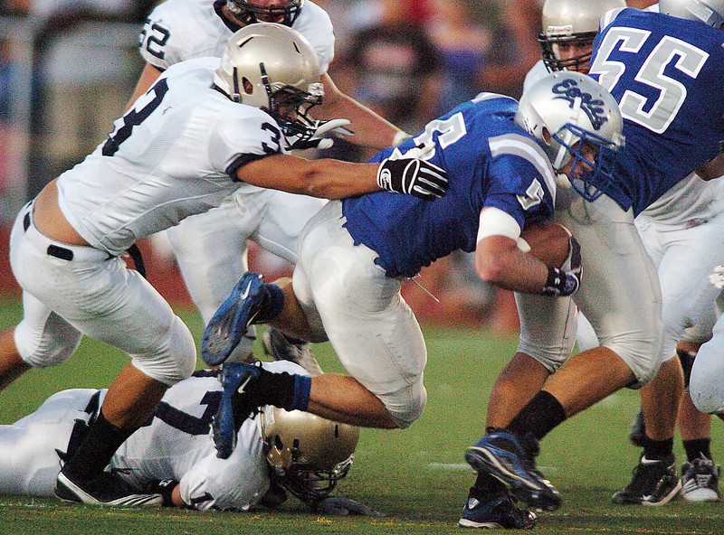 BE0919FOOT02<br /> Broomfield's Dan Geubelle carries the ball while being tackled by Bob May, Legacy, during Saturday's cross town game at Elizabeth Kennedy Stadium..<br /> <br /> September 11, 2010<br /> staff photo/David R. Jennings