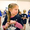 Allison Kirkpatrick, 5 3/4, waits to rehearse during the Lil' Poms clinic, a fundraiser for the Broomfield High pom squad on Friday. <br /> February 10, 2011<br /> staff photo/David R. Jennings