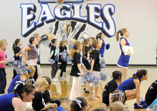 Girls in the Lil' Poms clinic lead by the juniors in the Broomfield Pom Squad rehearse in the Broomfield Eagle gym for the halftime performance at halftime of the Broomfield girls game in the Wilkerson gym on Friday. <br /> February 10, 2011<br /> staff photo/David R. Jennings