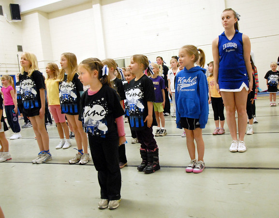 Lil' Poms participants learn how to come to attention during the clinic at Broomfield High on Friday. <br /> February 10, 2011<br /> staff photo/David R. Jennings